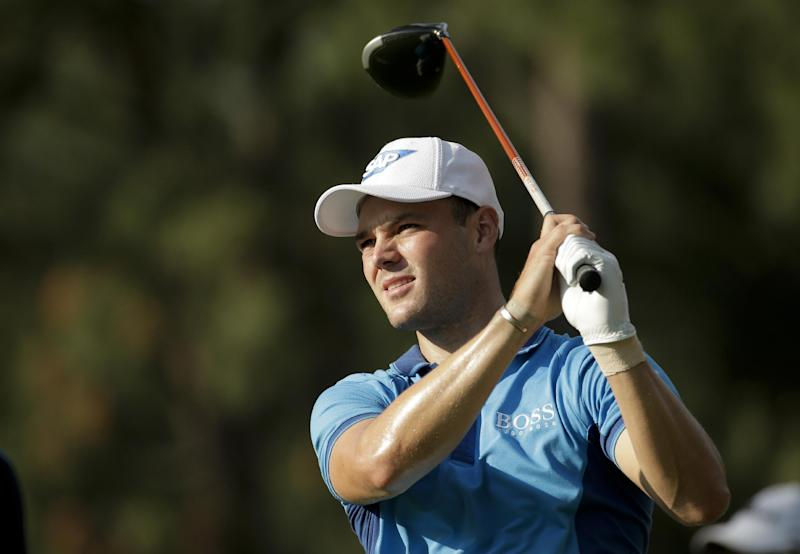 Martin Kaymer, of Germany, watches his tee shot on the 18th hole during the first round of the U.S. Open golf tournament in Pinehurst, N.C., Thursday, June 12, 2014. (AP Photo/Charlie Riedel)