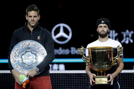 Tennis - China Open - Men's Singles - Final - National Tennis Center, Beijing, China - October 7, 2018. Nikoloz Basilashvili of Georgia and Juan Martin del Potro of Argentina pose for a photo after the match. REUTERS/Jason Lee