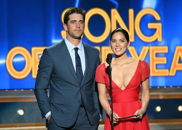 LAS VEGAS, NV - APRIL 06: NFL quarterback Aaron Rodgers (L) and actress Olivia Munn speak onstage during the 49th Annual Academy Of Country Music Awards at the MGM Grand Garden Arena on April 6, 2014 in Las Vegas, Nevada. (Photo by Ethan Miller/Getty Images)