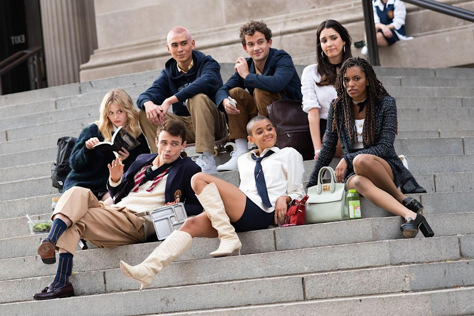 """<p>It's 2020, and <a href=""""https://www.elle.com/culture/movies-tv/a34641679/gossip-girl-reboot-cast-the-met-photos/"""" rel=""""nofollow noopener"""" target=""""_blank"""" data-ylk=""""slk:Gossip Girl is back"""" class=""""link rapid-noclick-resp""""><em>Gossip Girl</em> is back</a>. There's a brand-new cast and generation on the Upper East Side, and they've got a collective fashion sense that would surely be the envy of Blair Waldorf and Serena van der Woodsen. In the middle of a pandemic, it is pretty comforting to see all the bright colors out on the streets of Manhattan, during a year when going outside and dressing up has hardly been a focus. </p><p>If you take a look at the <a href=""""https://www.imdb.com/title/tt10653784/"""" rel=""""nofollow noopener"""" target=""""_blank"""" data-ylk=""""slk:IMDB page"""" class=""""link rapid-noclick-resp"""">IMDB page </a>for the show, there is only one character in this new friend group named, Emily Alyn Lind's character, Audrey. Jordan Alexander and Whitney Peak are apparently the other two main characters featured in the new collection of private-school New Yorkers. <a href=""""https://deadline.com/2020/03/gossip-girl-emily-alyn-lind-cast-star-reboot-series-hbo-max-1202871912/"""" rel=""""nofollow noopener"""" target=""""_blank"""" data-ylk=""""slk:According to Deadline"""" class=""""link rapid-noclick-resp"""">According to Deadline</a>, Audrey (Lind) """"has been in a long term relationship and is beginning to wonder what more could be out there."""" </p><p>The first season, which is expected to have 10 episodes, is also supposedly pretty queer, <a href=""""https://www.out.com/television/2020/11/11/new-queer-gossip-girl-series-shows-cast-first-look"""" rel=""""nofollow noopener"""" target=""""_blank"""" data-ylk=""""slk:per Out magazine"""" class=""""link rapid-noclick-resp"""">per <em>Out </em>magazine</a>. </p><p>""""How much homoeroticism can I expect from it?""""<a href=""""https://twitter.com/Anthologist/status/1317643152325550080?s=20"""" rel=""""nofollow noopener"""" target=""""_blank"""" data-ylk=""""slk:one fan tweeted"""" class=""""link rapid-noclick-resp""""> one"""