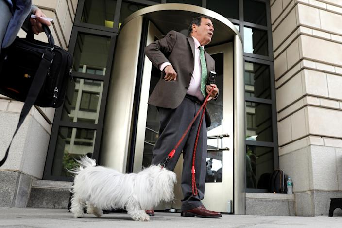 Radio host and comedian Randy Credico with his dog, Bianca, after testifying before a grand jury convened by special counsel Robert Mueller, in Washington, Sept. 7, 2018. (Photo: Yuri Gripas/Reuters)