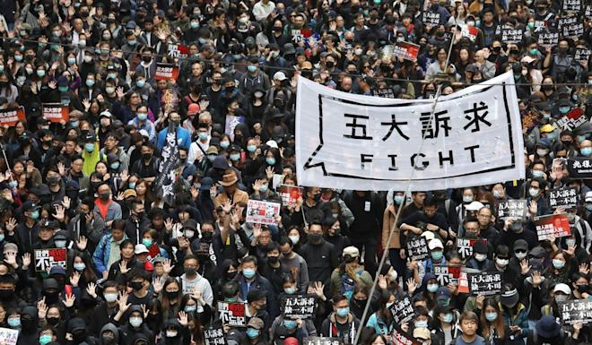 Anti-government protesters march through Causeway Bay in Hong Kong on January 1. Photo: Nora Tam