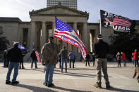 People take part in a rally at the Legislative Plaza, Wednesday, Jan. 6, 2021, in Nashville, Tenn. Two Tennessee lawmakers organized a prayer rally timed to coincide with a protest in the nation's Capitol in support of President Donald Trump's baseless claims that he won reelection. (AP Photo/Mark Humphrey)