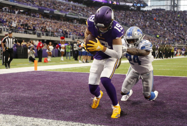 FILE -In this Sunday, Nov. 4, 2018, file photo, Minnesota Vikings wide receiver Adam Thielen (19) catches a 2-yard touchdown pass ahead of Detroit Lions cornerback Nevin Lawson, right, during the first half of an NFL football game in Minneapolis. Thielen has already set all kinds of records this year for Minnesota. He couldn't do it without teammate Stefon Diggs, though. This dominant wide receiver duo is a major reason why the Vikings remain in the mix with the NFC's top contenders despite some rough spots in the first half of the season. (AP Photo/Bruce Kluckhohn, File)