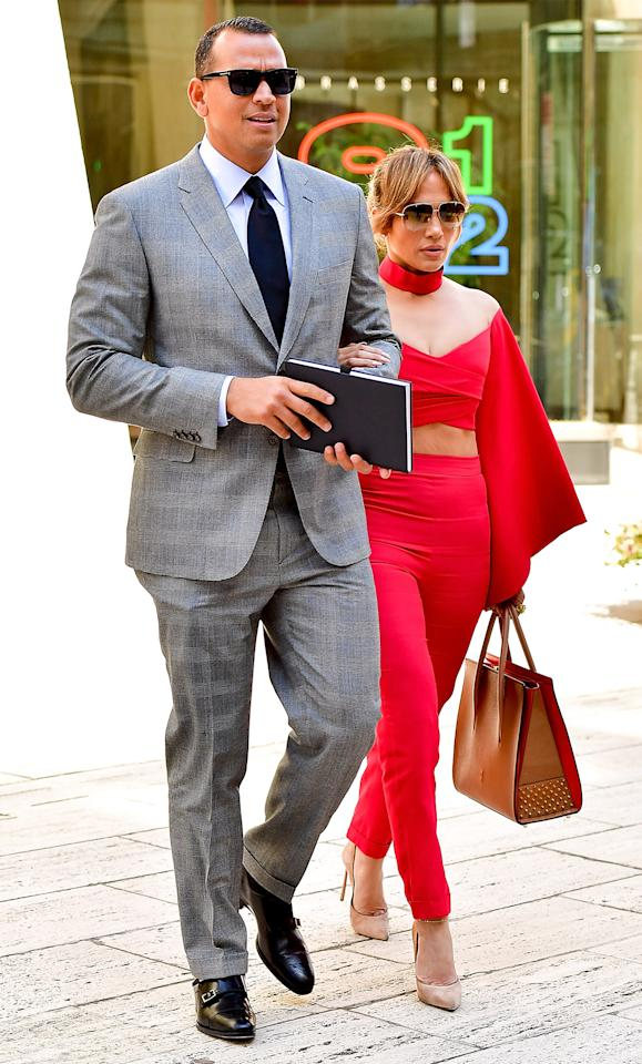 """<p>Lopez was a vision in red on Monday afternoon while taking a stroll with her new beau. The singer paired an off-the-shoulder Balmain crop top ($2,835; <a rel=""""nofollow"""" href=""""https://www.net-a-porter.com/us/en/product/856261/Balmain/cropped-mesh-paneled-crepe-top"""">net-a-porter.com</a>) with matching high-waist pants, nude Casadei pumps ($750; <a rel=""""nofollow"""" href=""""http://www.casadei.com/en/shoes/pumps/blade-pandora-1F090D125TT70495H.html?cgid=shoes-pumps#start=39"""">casadei.com</a>), and her favorite red-accented Christian Louboutin tote ($2,490; <a rel=""""nofollow"""" href=""""http://www.neimanmarcus.com/Christian-Louboutin-Paloma-Large-Triple-Gusset-Tote-Bag-Beige/prod192400239/p.prod?icid=&searchType=MAIN&rte=%2Fsearch.jsp%3Ffrom%3DbrSearch%26request_type%3Dsearch%26search_type%3Dkeyword%26q%3DPaloma+Large+Triple-Gusset+Tote+Bag%2C+Beige&eItemId=prod192400239&cmCat=search&tc=2&currentItemCount=1&q=Paloma+Large+Triple-Gusset+Tote+Bag%2C+Beige&searchURL=/search.jsp%3Ffrom%3DbrSearch%26start%3D0%26rows%3D30%26q%3DPaloma+Large+Triple-Gusset+Tote+Bag%2C+Beige%26l%3DPaloma+Large+Triple-Gusset+Tote+Bag%2C+Beige%26request_type%3Dsearch%26search_type%3Dkeyword"""">neimanmarcus.com</a>).</p>"""