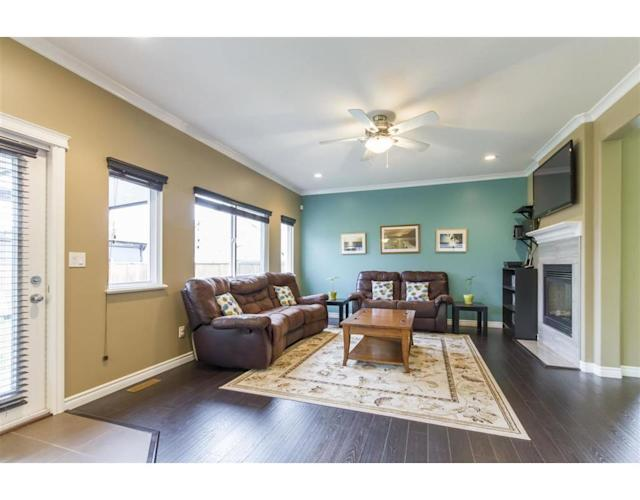 """<p><a href=""""https://www.zoocasa.com/pitt-meadows-bc-real-estate/5425515-19487-hoffmann-way-pitt-meadows-bc-v3y2w8-r2285476"""" rel=""""nofollow noopener"""" target=""""_blank"""" data-ylk=""""slk:19487 Hoffmann Way, Pitt Meadows, B.C."""" class=""""link rapid-noclick-resp"""">19487 Hoffmann Way, Pitt Meadows, B.C.</a><br> This 2,590-square-foot home has nine-foot ceilings, which feel even more spacious thanks to the open concept layout.<br> (Photo: Zoocasa) </p>"""