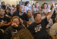 St. Paul Olympian Sunisa Lee's parents Yeev Thoj, left, and John Lee and other family and friends react as they watch Sunisa Lee clinch the gold medal in the women's Olympic gymnastics all-around at the Tokyo Olympics Thursday, July 29, 2021 in Oakdale, Minn. (Elizabeth Flores/Star Tribune via AP)