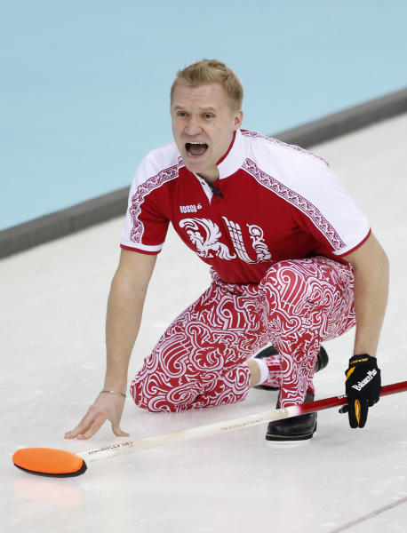 Russia's skip Alexey Stukalskiy shouts instructions after delivering the rock against Great Britain in men's curling competition at the 2014 Winter Olympics, Monday, Feb. 10, 2014, in Sochi, Russia. (AP PhotoRobert F. Bukaty