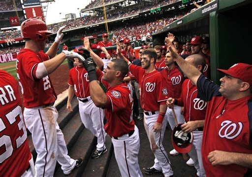 Washington Nationals first baseman Adam LaRoche, left, celebrates with his teammates after his two-run homer during the second inning of a baseball game with the St. Louis Cardinals at Nationals Park Saturday, Sept. 1, 2012, in Washington. (AP Photo/Alex Brandon)