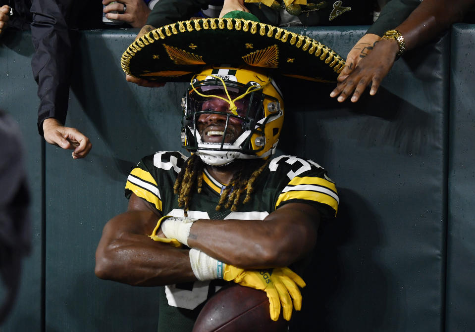 Aaron Jones of the Green Bay Packers wears a sombrero after scoring a touchdown against the Detroit Lions. (Photo by Quinn Harris/Getty Images)