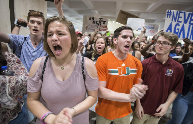 <p>Students chant protest slogans outside the Florida House of Representatives chamber inside the Florida Capitol in Tallahassee, Fla., Feb 21, 2018. (Photo: Mark Wallheiser/AP) </p>