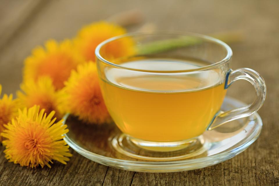 Dandelion tea cleanses the liver, which over time can help clear your skin. (Photo: Getty Images)
