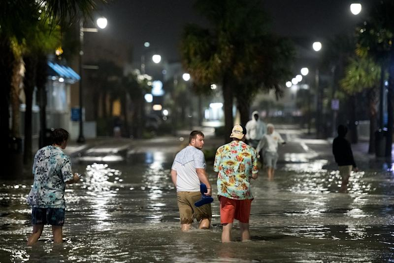 People walk through floodwaters on Ocean Blvd in Myrtle Beach, South Carolina on Monday: Getty Images
