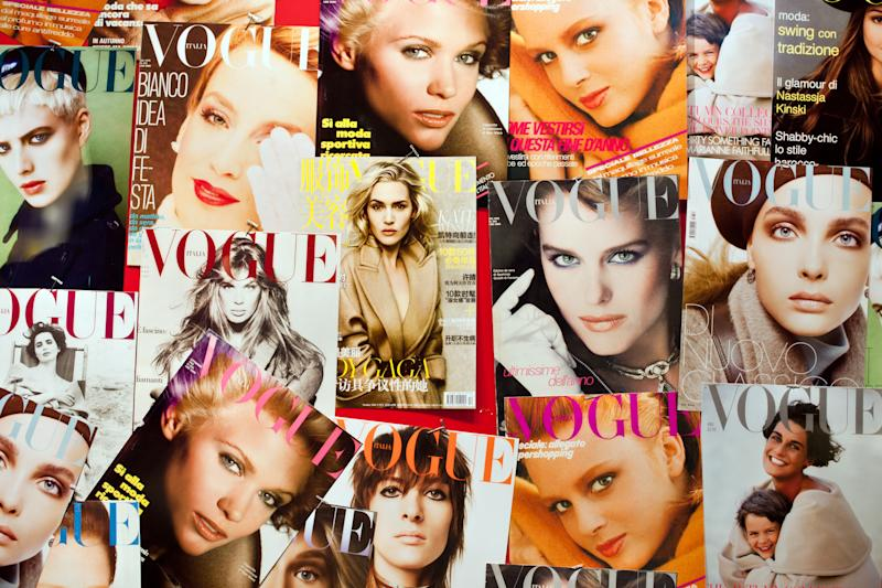"""""""Rome, Italy - September 21, 2011: Lots of covers of Italian Vogue, fashion and lifestyle magazine from 1892 that is published in different countries and languages"""""""