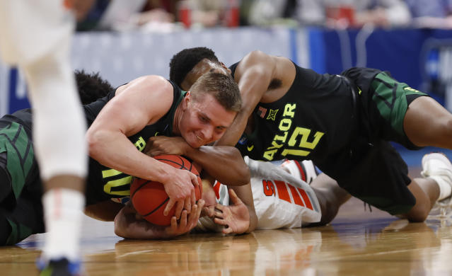 Baylor guardsMakai Mason (10) and Jared Butler (12) battle for the loose ball against Syracuse forward Elijah Hughes during the first half of a first-round game in the NCAA mens college basketball tournament Thursday, March 21, 2019, in Salt Lake City. (AP Photo/Jeff Swinger)