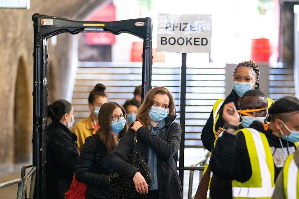 People queue to enter a Covid-19 vaccination event at Heaven nightclub in central London  (PA Wire)