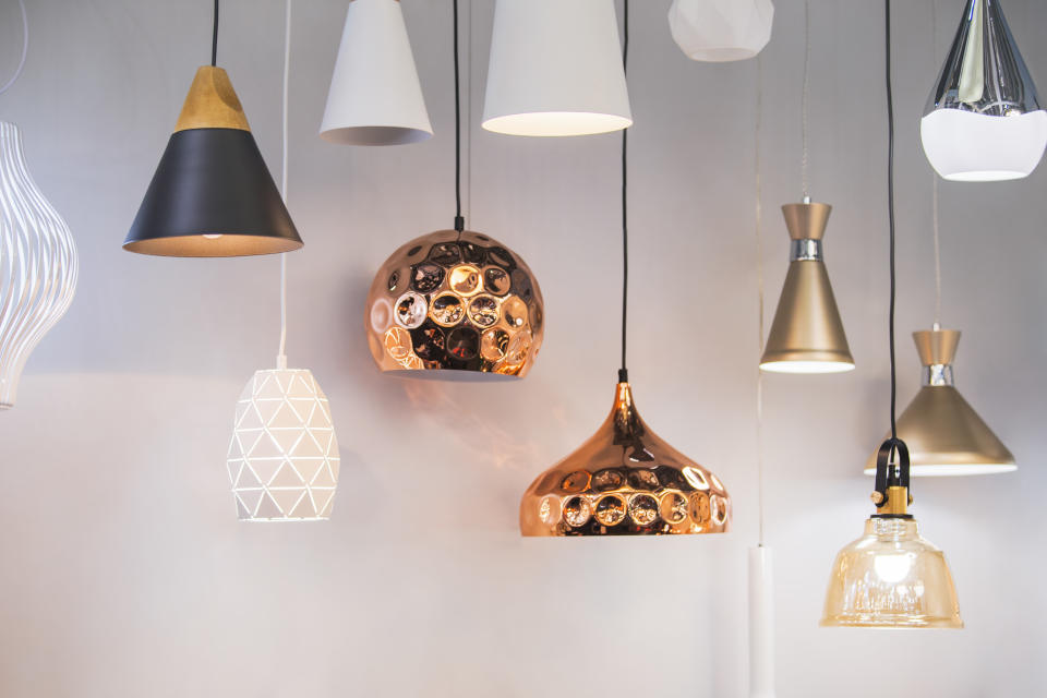 Different modern streamlined mirror copper chandeliers. Bubble metal copper shade pendant.