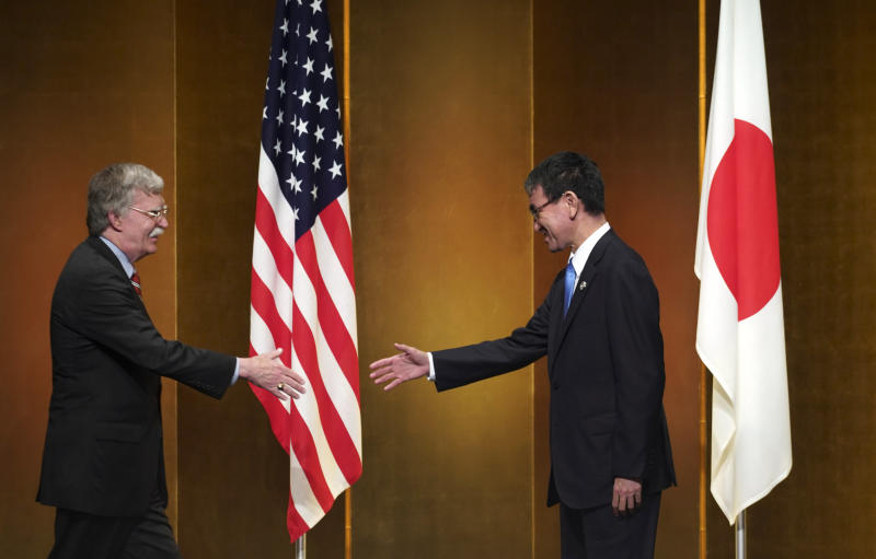 U.S. National Security Adviser John Bolton, left, and Japanese Foreign Minister Taro Kono prepare to shake hands before their meeting ahead of the G-20 summit in Osaka, western Japan, Thursday, June 27, 2019. (AP Photo/Eugene Hoshiko, Pool)