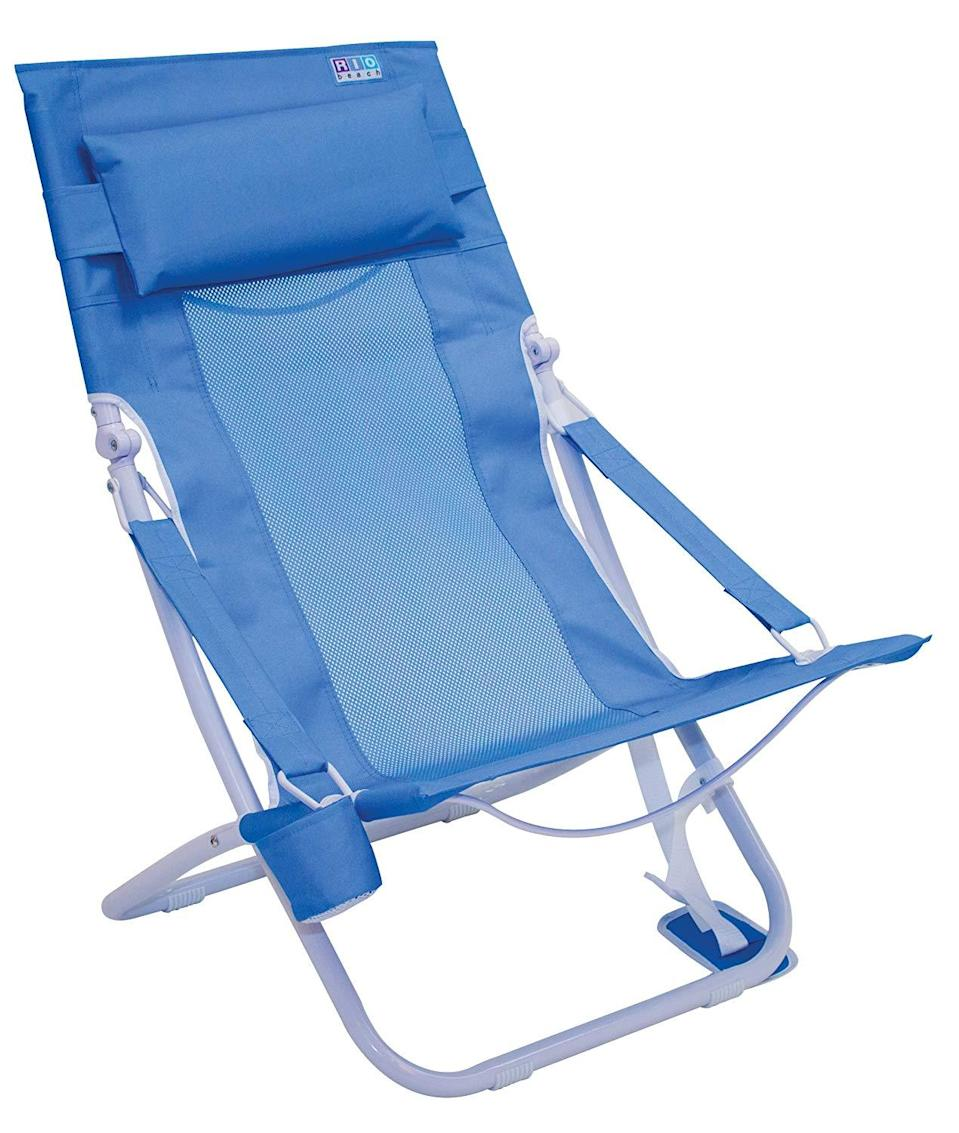 """<h3><h2>Rio Portable & Compact Sling Chair</h2></h3><br>This compact steel-framed chair comes equipped with a ventilating mesh center, foam-pillow headrest, extended seat depth, drink holder, and carrying strap for easy toting that reviewers describe as, """"Super comfortable. I have a 15-minute walk to the beach and carry it back and forth with no problem. It's fairly lightweight but heavy enough to be sturdy. Good deal.""""<br><br><em>Shop</em> <strong><em><a href=""""https://amzn.to/3eAMGzM"""" rel=""""nofollow noopener"""" target=""""_blank"""" data-ylk=""""slk:Rio"""" class=""""link rapid-noclick-resp"""">Rio</a></em></strong><br><br><strong>RIO Brands</strong> Portable Compact Fold Breeze Beach Sling Chair, $, available at <a href=""""https://amzn.to/33zZhwJ"""" rel=""""nofollow noopener"""" target=""""_blank"""" data-ylk=""""slk:Amazon"""" class=""""link rapid-noclick-resp"""">Amazon</a>"""