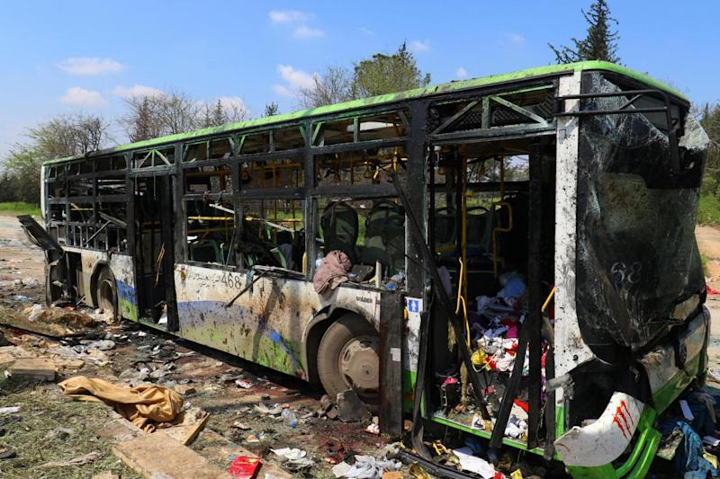 A damaged bus is seen after an explosion on Saturday (REUTERS)