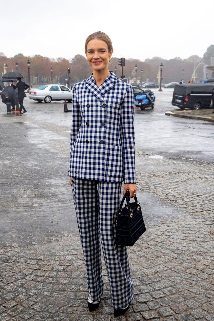 <p><strong>29 September </strong>Natalia Vodianova arrived at the show in a chic checked Dior suit.</p>