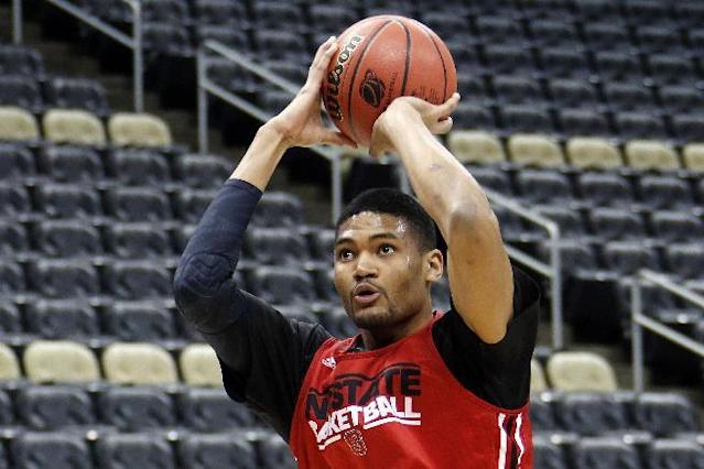 North Carolina State's Kyle Washington runs a drill during a practice for an NCAA college basketball second-round game in Pittsburgh, Wednesday, March 18, 2015. NC State is to plays LSU on Thursday. (AP Photo/Gene J. Puskar)