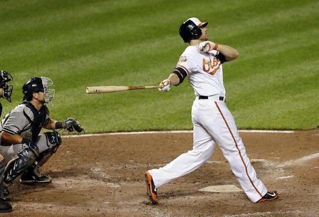 Baltimore Orioles first baseman Chris Davis watches his two-run home run in the fifth inning of a baseball game against the New York Yankees, Monday, Aug. 11, 2014, in Baltimore. (AP Photo/Patrick Semansky)
