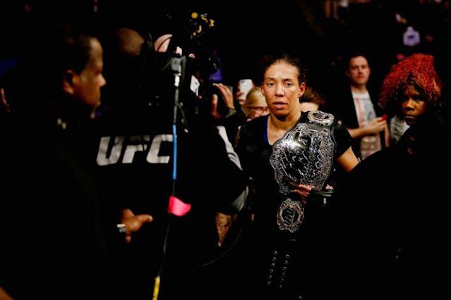 Germaine de Randamie walks through the crowd after beating Holly Holm to win the UFC women's featherweight title. (Getty)