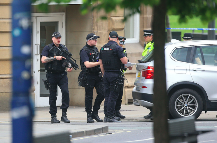 Armed police are patrolling the streets of Manchester (PA)