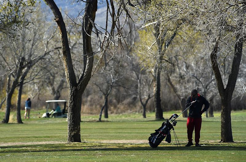 Golfers take advantage of a beautiful morning at Washoe County Golf Course in Reno on April 2, 2020.