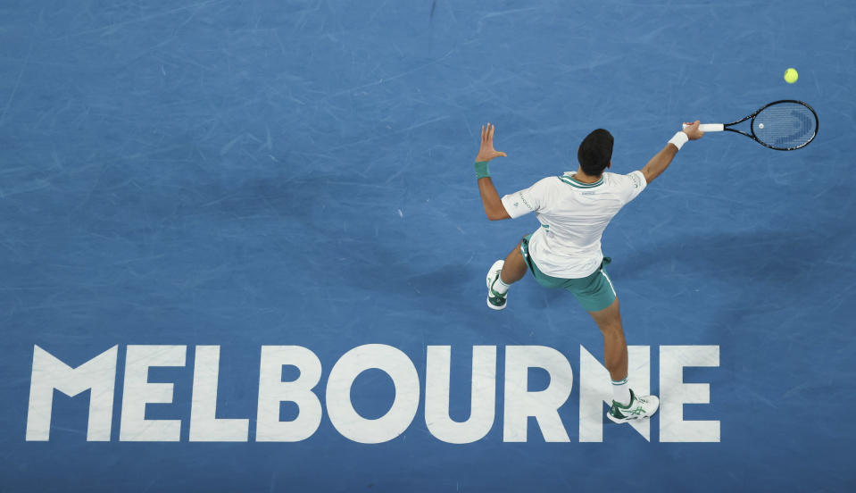 Serbia's Novak Djokovic hits a forehand return to Russia's Aslan Karatsev during their semifinal match at the Australian Open tennis championship in Melbourne, Australia, Thursday, Feb. 18, 2021.(AP Photo/Hamish Blair)