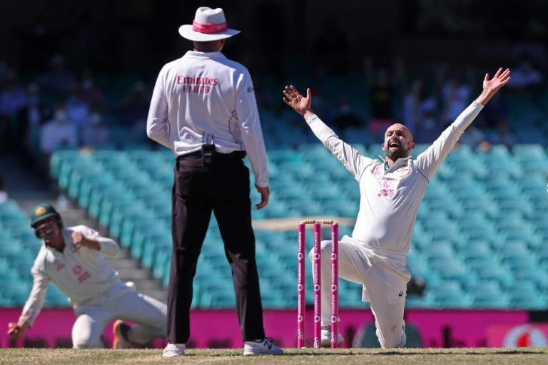 Australia's off-spinner Nathan Lyon (right) will play his 100th Test at Brisbane, starting FridaY