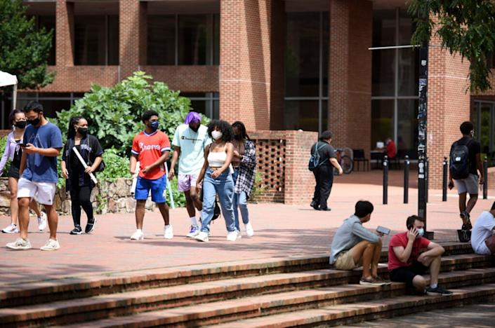 Students walk through the campus of the University of North Carolina at Chapel Hill on August 18, 2020 in Chapel Hill, North Carolina. (Photo by Melissa Sue Gerrits/Getty Images)
