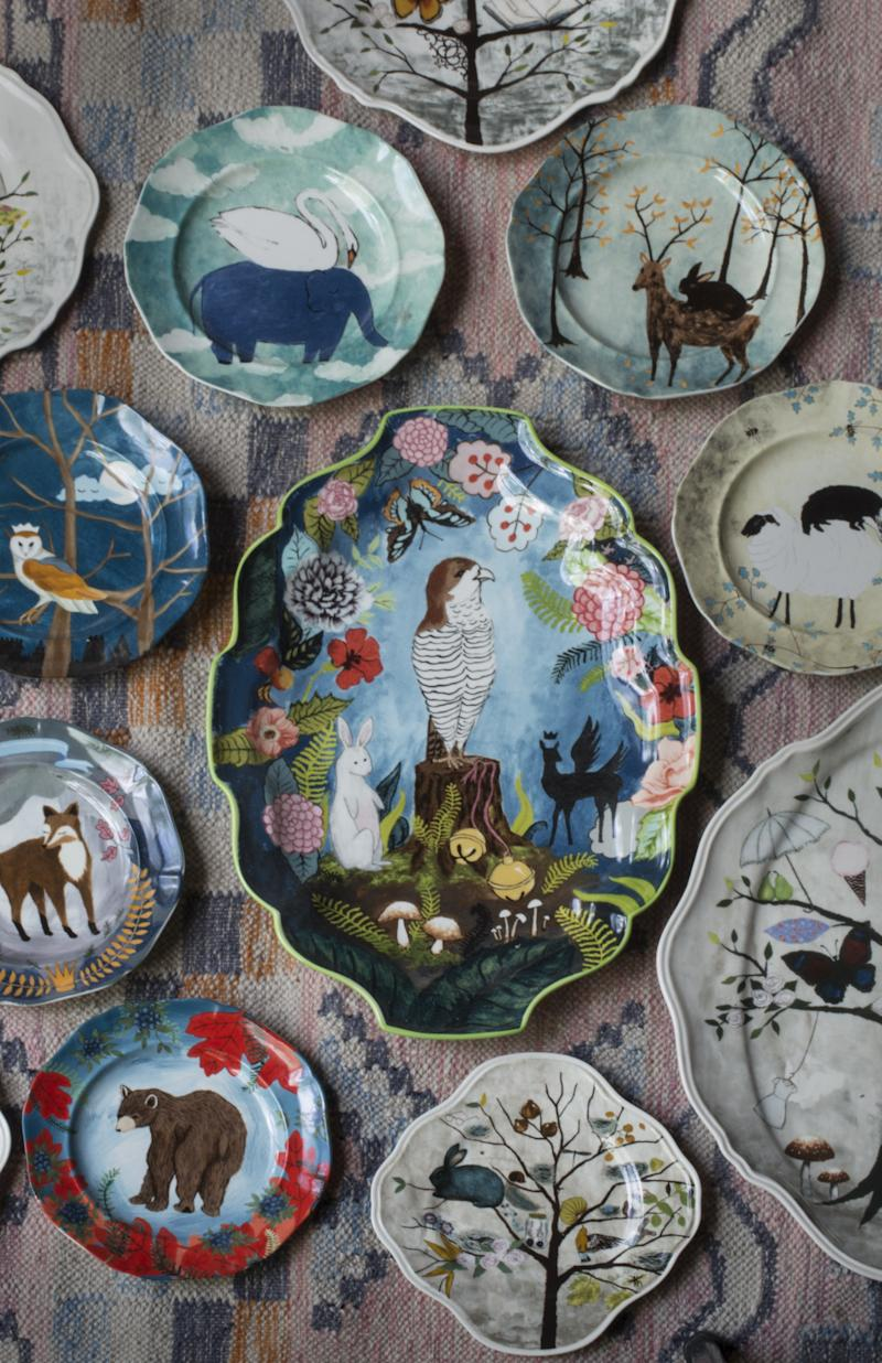 """Rebecca's """"Treehouse"""" in the Covington Woods is a three-story house with ample room for painting and excellent viewing areas to watch for forest animals. Many of the woodland creatures appear in her work, including several featured in this series of plates and platters she created for Anthropologie."""