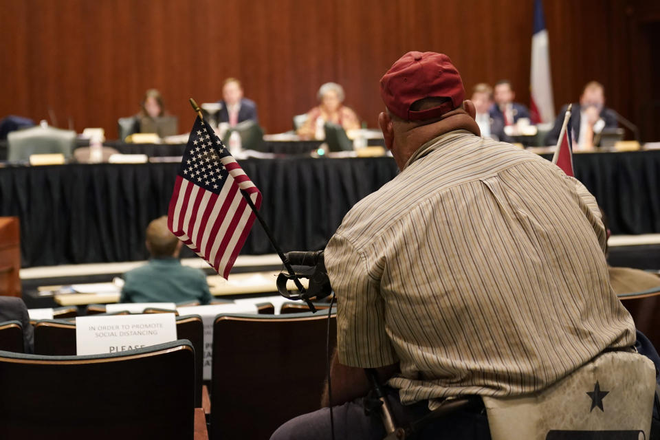 A Texas State House committee listens to a witness during a hearing over an election bill at the Texas Capitol in Austin, Texas, Monday, Aug. 23, 2021. (AP Photo/Eric Gay)