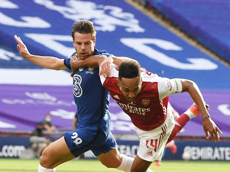 Cesar Azpilicueta brings down Pierre-Emerick Aubameyang in the Chelsea box for a penalty: Arsenal FC via Getty Images