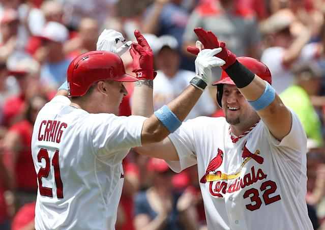 St. Louis Cardinals' Matt Adams, right, celebrates with teammate Allen Craig after hitting a two-run home run in the second inning of a baseball game against the Washington Nationals on Sunday, June 15, 2014, at Busch Stadium in St. Louis. Adams has hit home runs in three consecutive games since returning from the disabled list. (AP Photo/St. Louis Post-Dispatch, Chris Lee)