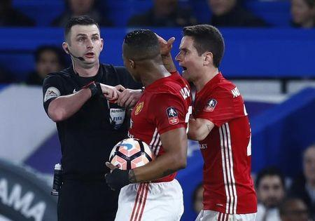 Manchester United's Ander Herrera is shown a red card by referee Michael Oliver
