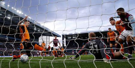 Soccer Football - Championship - Aston Villa vs Wolverhampton Wanderers - Villa Park, Birmingham, Britain - March 10, 2018 Wolverhampton Wanderers goalkeeper John Ruddy looks on as Aston Villa's Albert Adomah scores their first goal Action Images/Andrew Couldridge