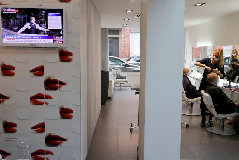 A screen tv is seen in a hairdresser shop in Cambrai a few hours before introducing a new lockdown
