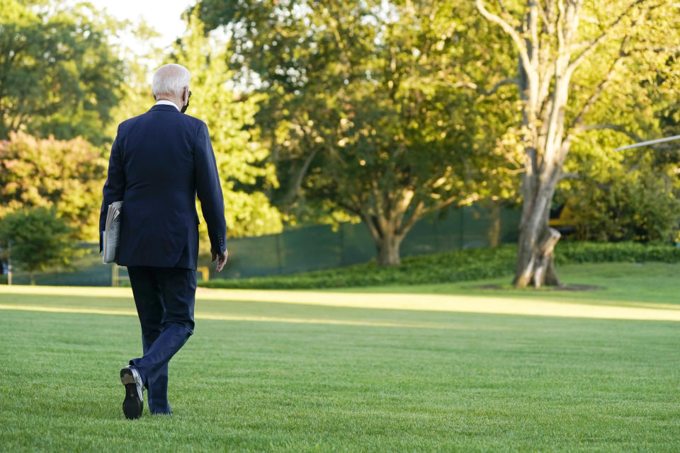 In this Sept. 24, 2021 photo, President Joe Biden walks to board Marine One on the South Lawn of the White House in Washington. President Joe Biden's popularity has slumped — with half of Americans now approving and half disapproving of his leadership. That's according to a new poll by The Associated Press-NORC Center for Public Affairs Research. (AP Photo/Evan Vucci)