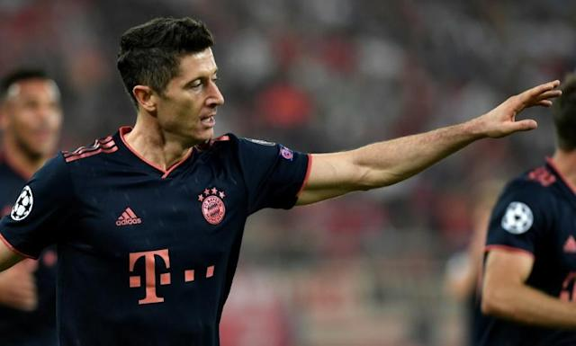 Robert Lewandowski scored twice at Olympiakos on Tuesday as Bayern Munich came from behind to win 3-2 in Athens in the Champions League. (AFP Photo/LOUISA GOULIAMAKI )