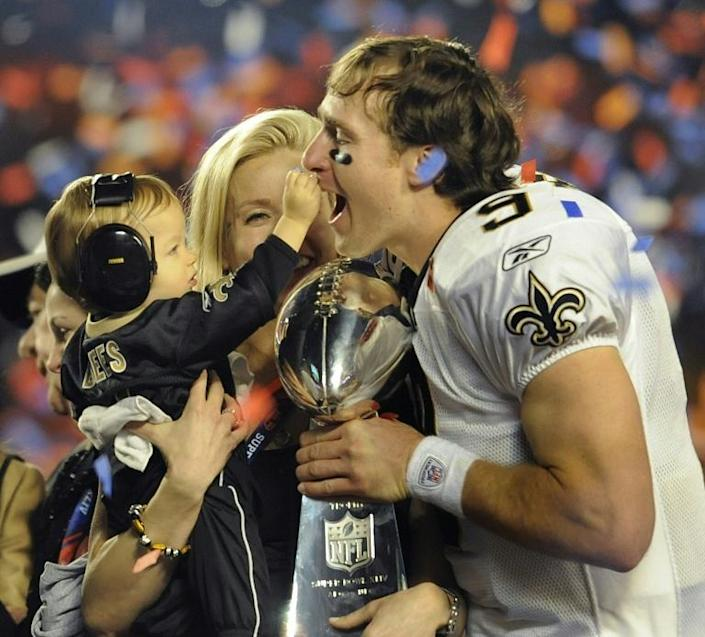 New Orleans quarterback Drew Brees celebrates with son Baylen after the Saints defeated the Indianapolis Colts during Super Bowl XLIV on February 7, 2010