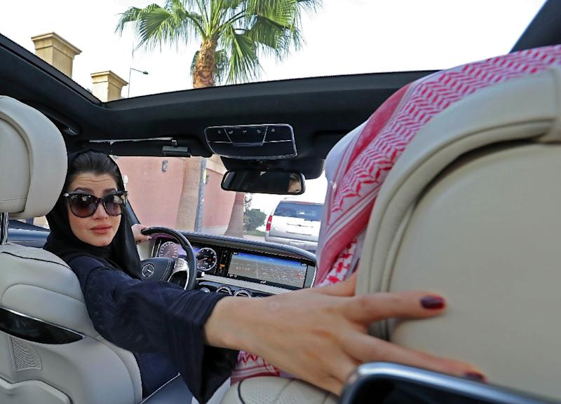 A Saudi woman practices reversing a car in Riyadh on April 29, 2018, ahead of the lifting of a ban on women driving (AFP Photo/Yousef DOUBISI)