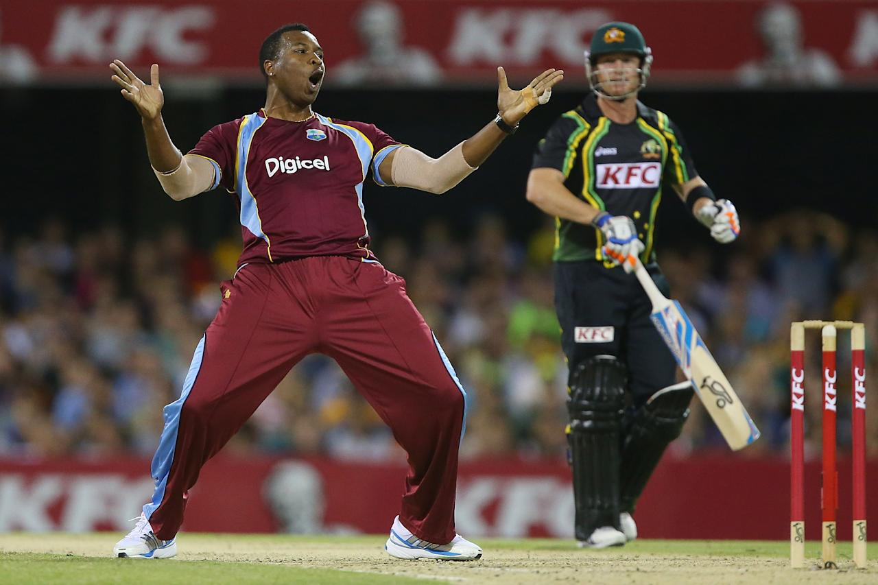 BRISBANE, AUSTRALIA - FEBRUARY 13:  Kieron Pollard of the West Indies celebrates after dismissing Brad Haddin of Australia during the International Twenty20 match between Australia and the West Indies at The Gabba on February 13, 2013 in Brisbane, Australia.  (Photo by Chris Hyde/Getty Images)