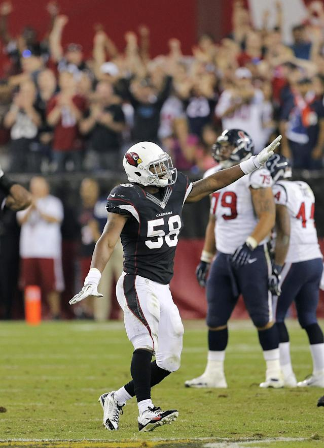 Arizona Cardinals inside linebacker Daryl Washington (58) celebrates as time expires against the Houston Texans during an NFL football game Sunday, Nov. 10, 2013, in Glendale, Ariz. The Cardinals won 27-24. (AP Photo/Matt York)
