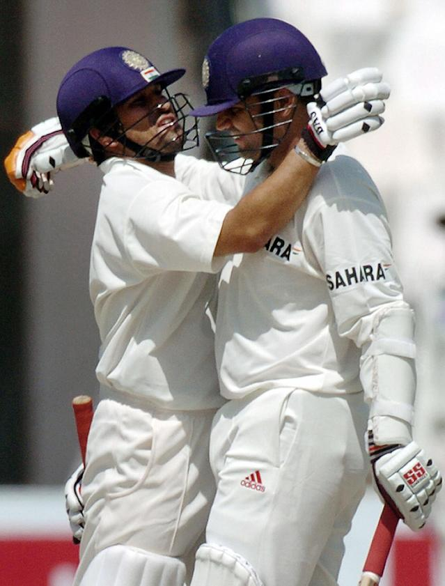 MULTAN, PAKISTAN: Indian batsman Virender Sehwag (R) is congratulated by his teammate Sachin Tendulkar after his triple century during the second day of the first Test match between Pakistan and Indian in Multan, 29 March 2004. Sehwag hit a triple century and became the highest Indian Test scorer. AFP PHOTO/Jewel SAMAD (Photo credit should read JEWEL SAMAD/AFP/Getty Images)