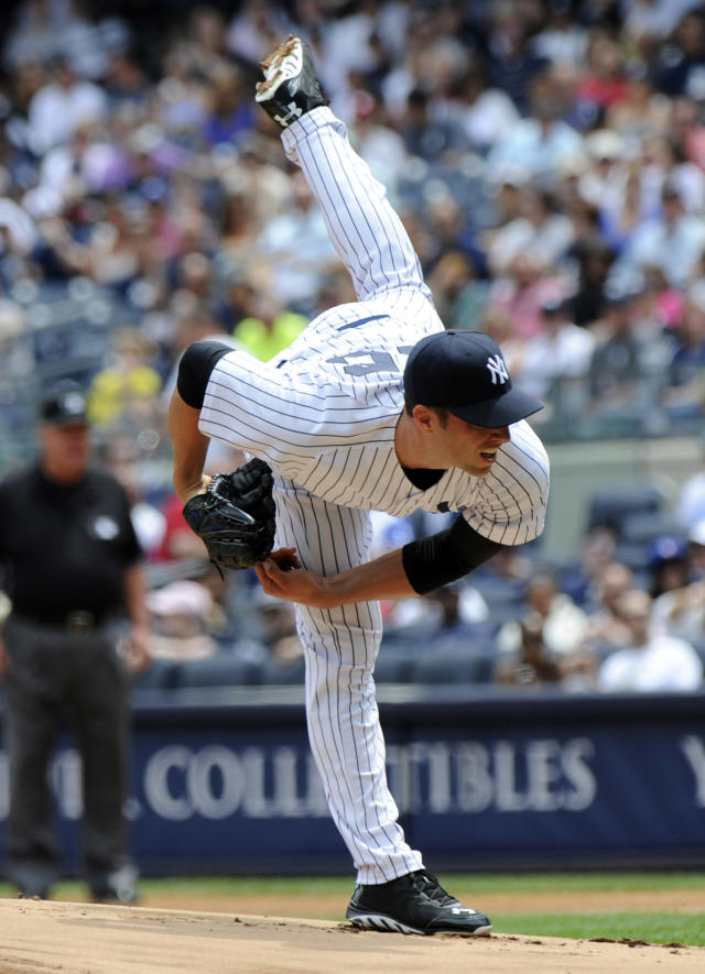 New York Yankees pitcher Chris Capuano delivers the ball to the Toronto Blue Jays during the first inning of a baseball game on Saturday, July 26, 2014, at Yankee Stadium in New York. (AP Photo/Bill Kostroun)