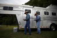 Wade Earp, 49, (L) and his husband Jonathan Suder, 25, from Dallas step out of their horse trailer at the International Gay Rodeo Association's Rodeo In the Rock in Little Rock, Arkansas, United States April 26, 2015. REUTERS/Lucy Nicholson