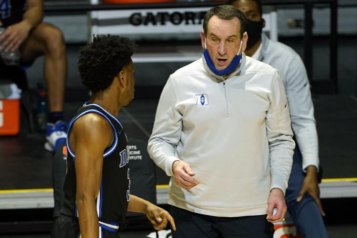 FILE - In this Feb. 1, 2021, file photo, Duke head coach Mike Krzyzewski talks to guard Jeremy Roach (3) during the second half of an NCAA college basketball game against Miami in Coral Gables, Fla. Krzyzewski's Blue Devils host rival North Carolina on Saturday, Feb. 6, 2021, with it marking the first meeting with both teams unranked since 1960. (AP Photo/Marta Lavandier, File)